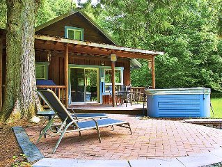 Riverfront Cabin w Hot Tub and Sauna Close to Stevens! 5 Private Acres!