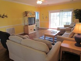 This ground floor condo offers pool, wifi, washer and dryer! Minutes from Beach!