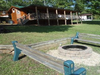 Stay just steps to the water! Fire pit, boat slip, canoe, wifi,lake & Mtn views.