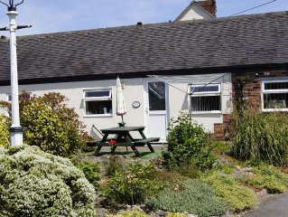 Family friendly cottages, play barn for all ages, laundry and summer house