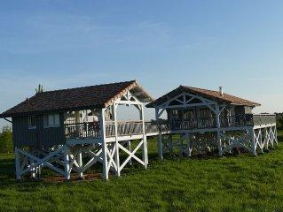 Maison sur pilotis et son studio inspirée par les carrelets de l'estuaire