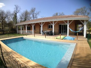 Wood house, heated pool with fence, close to the beach and the village