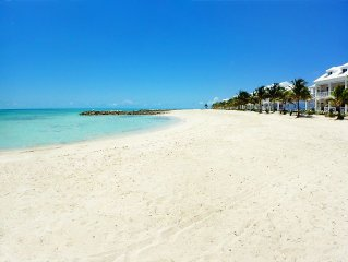 On the Beach - White Sand - Turquoise Water - Palm Cay