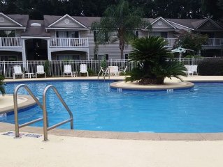 Immaculate 2 Bedroom 2 Bath condo with private patio across street from pool
