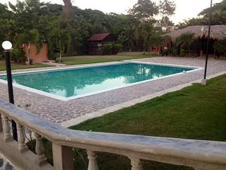 POOL!  TWO AIR CONDITIONED BEDROOMS, PRIVATE GARDEN, GATED SECURITY, SEMI RESORT