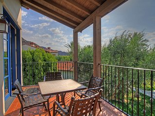 Upstairs Two Bedroom Legacy Villa Steps from the Pool on a Secluded Greenbelt