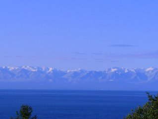 Spectacular West side views of Strait, Olympics, Victoria, south to Mt Rainier.