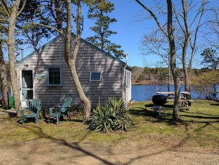 Eastham waterfront cottage on pond with private beach dock and boats