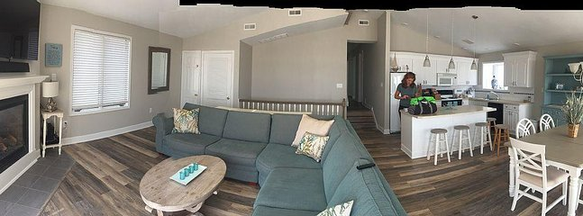 Panoramic of renovated flooring, kitchen and family room