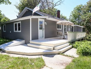 Walk to downtown Saugatuck from this cottage on the hill !