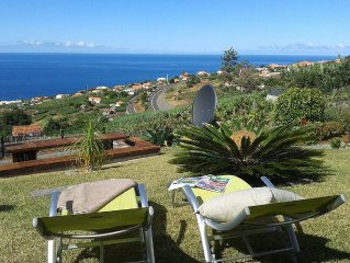 Holiday house with stunning views over mountains and the sea, large garden with