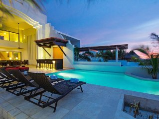 A modern beachfront villa for families, large group.
