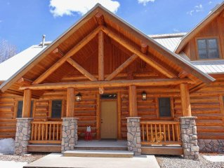 RITZ ON THE RIVER--A GORGEOUS LOG CABIN IN THE HEART OF TOWN
