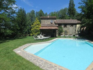 Pretty riverbank cottage with  lovely pool and garden.