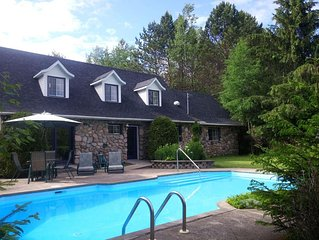 Luxury Executive Four Bedroom Lakefront Stone Chalet In-Ground Pool