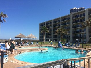 Beach Front Condo with 3 pools, 4 tennis courts, Drink & Food Cabanas