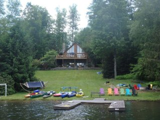 Lakefront Log Home with large porch, yard, firepit, kayaks/canoes, wifi, DirecTV