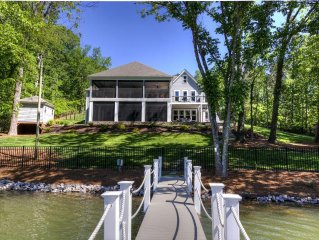 Expansive new custom NC lake front home with pool & dock