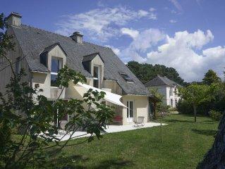 DRC quiet garden and the sea, Rhuys peninsula. Near Gulf of Morbihan