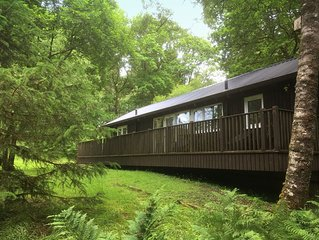 LIEVER is a charming log cabin in a beautiful forest location close to Loch Awe