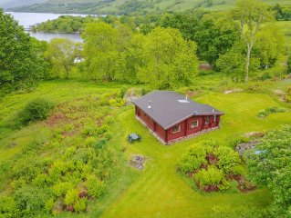 Log Cabin with private grounds and beach.  Fishing rights and amazing views.