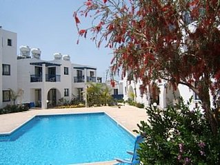 Ground Floor Apartment With Communal pool Short Walk To Beach and attractions