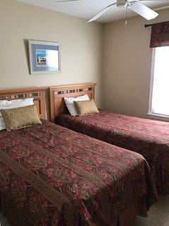 Bedroom, twin beds plus ceiling fan.