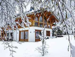 Spacious chalet for 10/12 with hot tub. Ideal for families, skiing, biking, golf