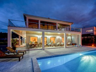 Luxury modern family villa with lagoon views, private heated pool, free wifi
