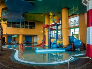 Kids-friendly Water Play Area, Pools, & Lazy River. Beach Service Included**
