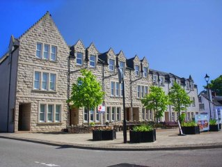 Modern luxury apartment overlooking the main square in Dornoch.