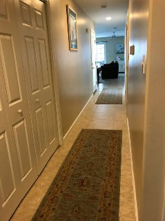 Hall to living area.  Double doors on left lead to laundry area.