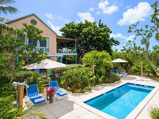 Grace Bay Beachfront 1 BR Beach Condo + Pool + Lush Gardens+Central Location