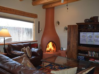 Wood burning kiva fireplace and flat screen TV satellite TV