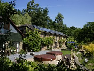 A large comfortable house with hot tubs and great rural views; a real rustic gem