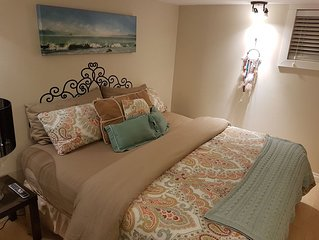 Downtown 3 Bedroom Basement with Private Hot Tub that sleeps 4 MAX