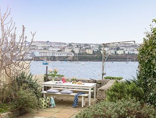 Watch the lapping waters of the Penryn River from this perfect