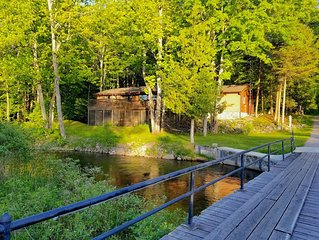 Secluded Cottage on the Boardman River w/ Hot Tub, Fireplace, & Internet