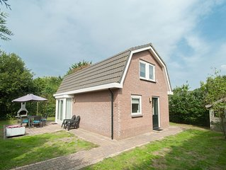 Detached bungalow with a big lovely garden and WiFi, in a park by the North Sea