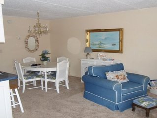 Furnished One Bedroom Condo. Water View, Heated Pool,remodeled marble bathroom.