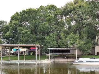 NEW LISTING! Charming Waterfront- Carport, Lake O Access, Covered Boat Docking