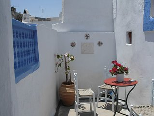 The Swallows' Nest:-Traditional Greek house with soaring central arch, and lofts