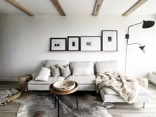 Stay in bear cave bunkbeds in this designer Scandinavian styled mountain home