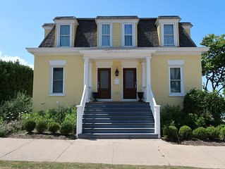 Big Yellow House with amazing sunset � views of Lake Michigan.  One of a kind.