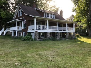 Lake view home 3 minute walk from Institute on .7  acres with swimming dock .
