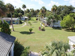Waterfront property with a quaint one bedroom cottage enjoy old Florida Charm