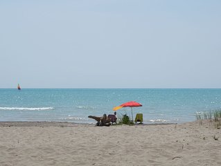 NEW LISING! RARE LONG POINT BEACH BEACHFRONT COTTAGE WITH MILES OF SANDY BEACH