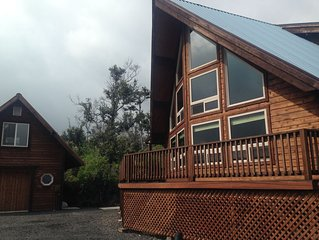 Quite, A-frame log home. Nestled on 2 acres of fruit trees and flowers.