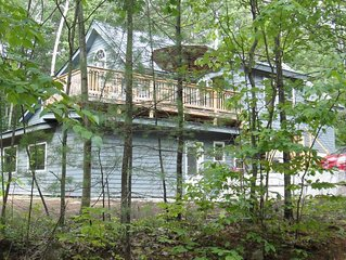 River Rock Chalet, in-law suite with 2 bedrooms, 1 bath, kitchen, deck, & porch.