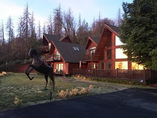 Stunning lodge style home on 8 private acres. Backs up to the national forest!